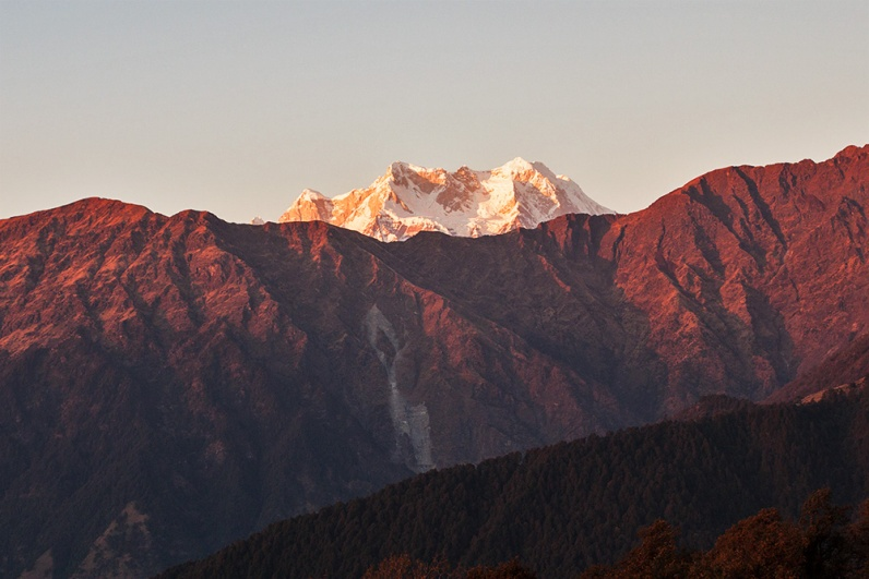 Sunset brightens Chaukhamba peaks