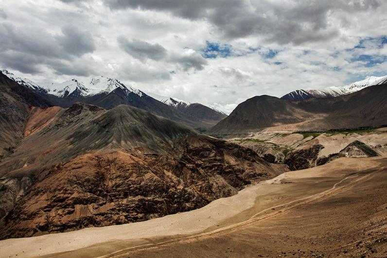 Snow peaks to barren landscape